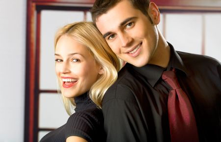amorous woman: Young attractive smiling couple or business people