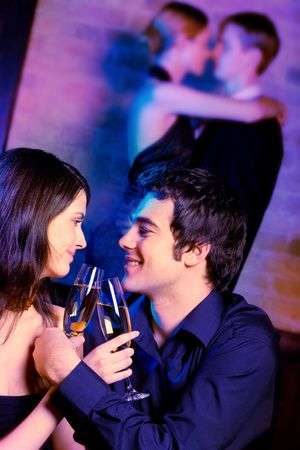 Two young attractive happy couples at celebration or night party  photo