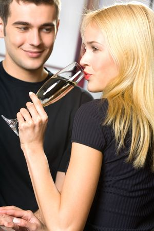 Young attractive happy smiling couple celebrating with champagne, indoors Stock Photo - 956012