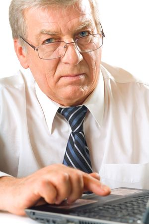 Elderly solid unhappy pensive business man or teacher on laptop, isolated on white background photo