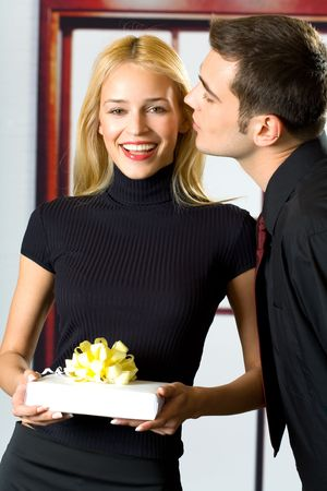 Young happy attractive happy smiling business people or couple with gift Stock Photo - 1281637