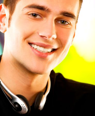 Young happy smiling successful man with headset outdoors Stock Photo - 1320142