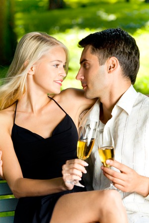 Happy successful attractive couple celebrating anniversary, life event or holiday together with champagne, outdoors Stock Photo - 1399281