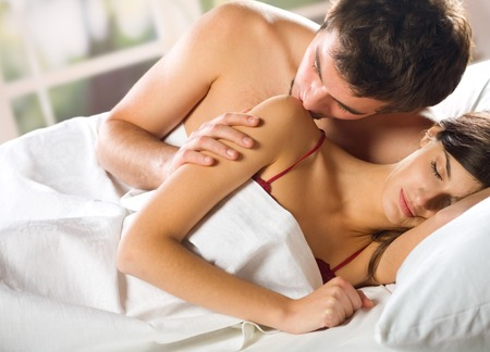 Young attractive happy couple embracing in bedroom Stock Photo - 1489213