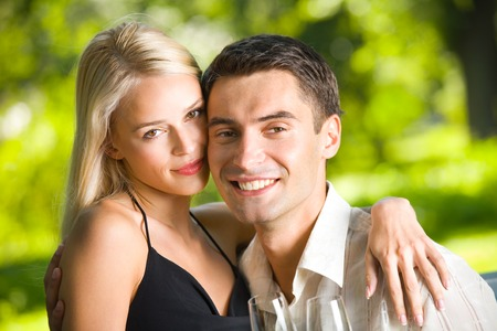 Young couple celebrating with champagne together, outdoors Stock Photo - 1528395
