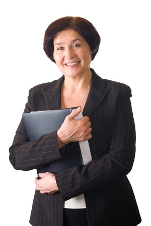 businesslady: Isolated happy senior successful businesswoman in suit with folder Stock Photo