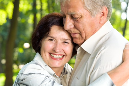 Senior happy smiling couple walking together outdoors  photo