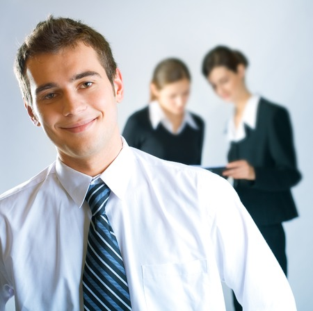 Three young successful businesspeople working at office photo