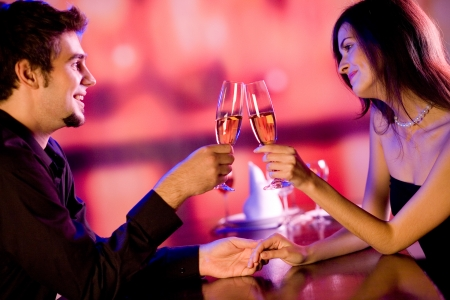 Young couple celebrating with champagne together photo