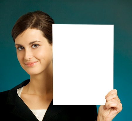 Young beautiful smiling student, secretary or businesswoman with blank  photo