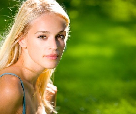 Portrait of young woman outdoors. You can use right part as copyspace. To provide maximum quality, I have made this image by combination of two photos. Stock Photo - 1677036