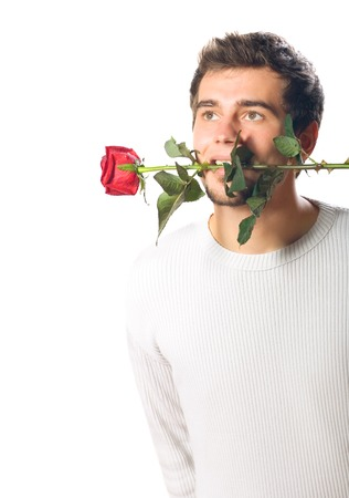 Young handsome man with rose. Isolated on white. photo
