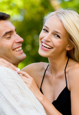 Young happy smiling attractive couple walking outdoors together Stock Photo - 1737478