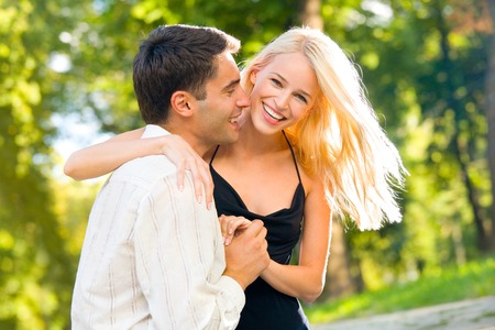 Young happy smiling attractive couple walking outdoors together photo