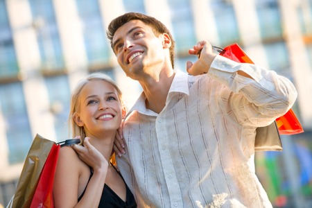 Young attractive happy couple with shopping bags outdoors Stock Photo - 1737421