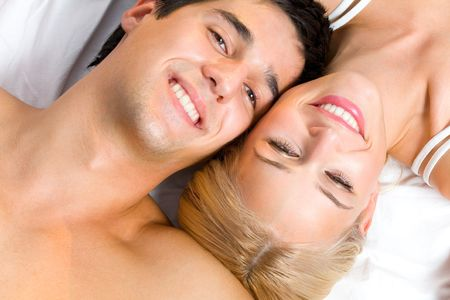 Portrait of young attractive happy amorous couple in bedroom Stock Photo - 1834201