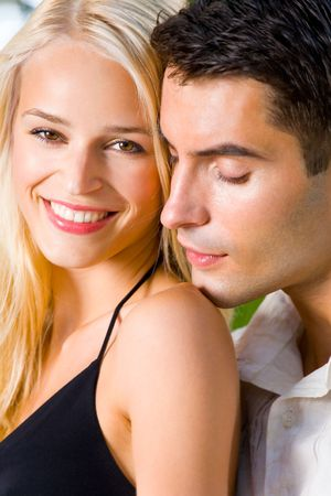 Portrait of young happy attractive couple together, outdoors Stock Photo - 1934361