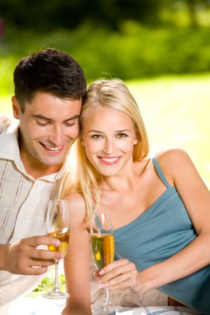 Young couple celebrating with champagne together, outdoors Stock Photo - 2027829