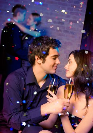 Young happy couple with champagne glasses at celebration Stock Photo - 2097736