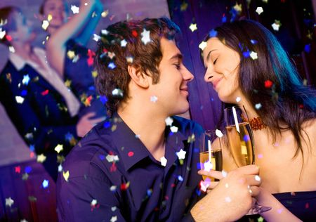 Young happy couple with champagne glasses at celebration Stock Photo - 2097758