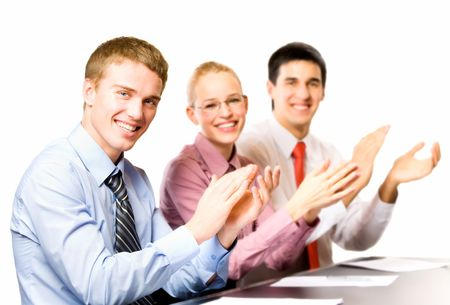 applaud: Three happy businesspeople at presentation, isolted on white