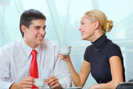 coffeebreak: Businessman and businesswoman drinking coffee at coffee-break