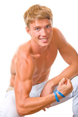 Portrait of handsome muscular young man flexing biceps, isolated