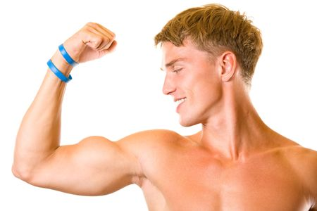 Portrait of handsome muscular young man flexing biceps, isolated photo