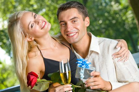 Funny young happy couple with gift and rosa, outdoors Stock Photo - 2457551