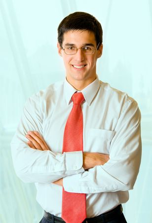 Portrait of young successful happy smiling businessman at office Stock Photo - 2457492