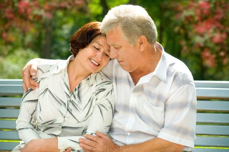 Mature attractive happy couple together in park Stock Photo - 2523265