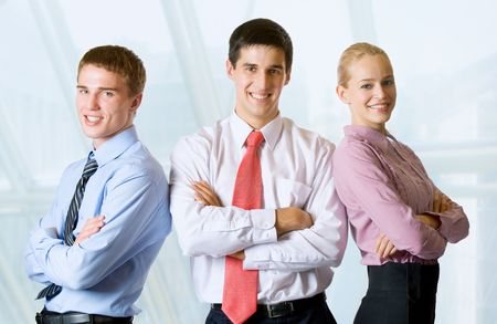 businessteam: Portrait of happy smiling successful businessteam at office Stock Photo