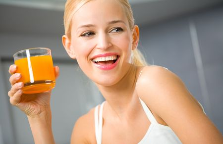 Young attractive happy woman with glass of juice  photo
