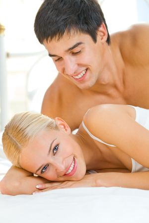 Portrait of young attractive happy amorous couple in bedroom Stock Photo - 2706670