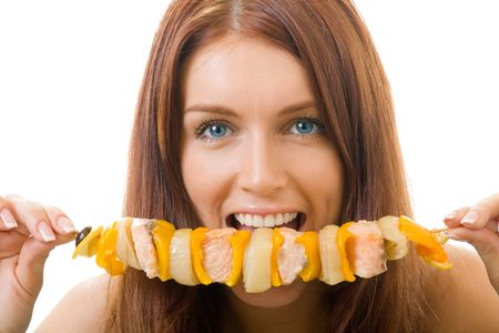 Portrait of young happy woman eating shish kebab, isolated Stock Photo - 2867869