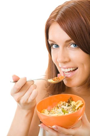 muslin: Portrait of young smiling woman eating muslin, isolated Stock Photo