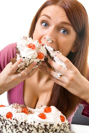 gluttonous: Young hungry gluttonous woman eating pie, isolated Stock Photo