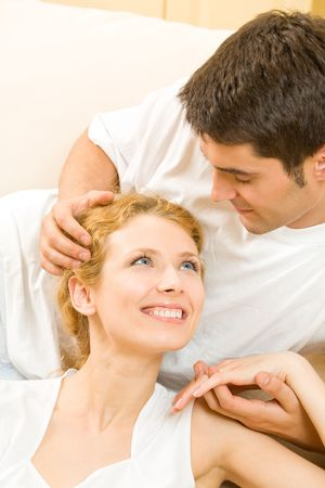 Portrait of young happy amorous couple at home photo
