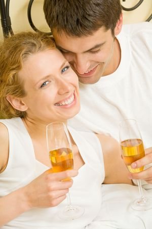 Young couple celebrating with champagne at bedroom Stock Photo - 2900234