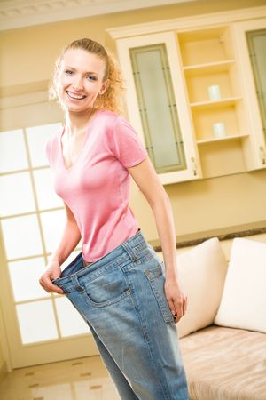 Young happy smiling slim woman wearing old jeans Stock Photo - 2995486