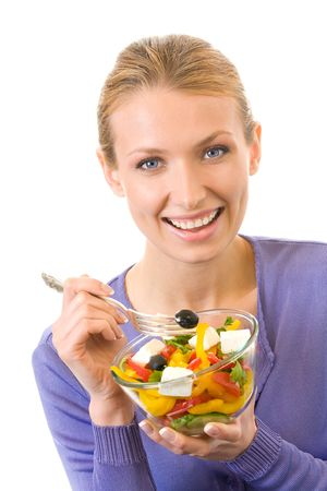 Young happy woman eating salad, isolated on white photo