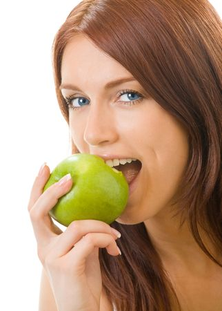 vitamine: Portrait of young happy woman eating apple, isolated