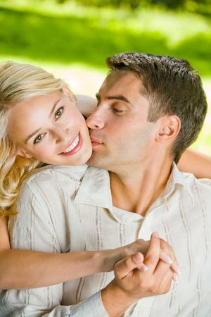 Young happy attractive couple walking together, outdoors photo