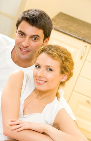 Portrait of young happy amorous couple at home Stock Photo - 3112946
