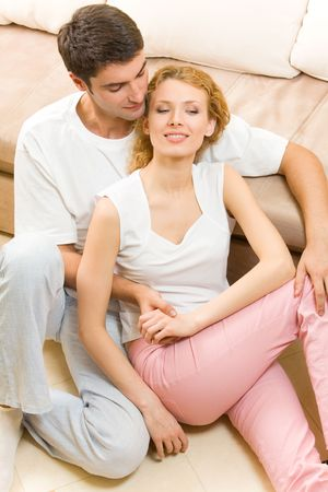 Portrait of young happy amorous couple at home Stock Photo - 3138717