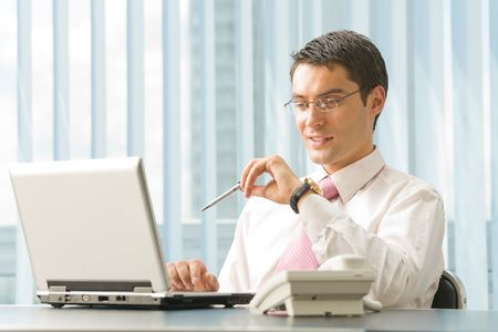 Portrait of happy smiling businessman with laptop at office Stock Photo - 3214212