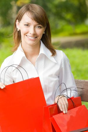 Young happy woman with shopping bags, outdoors Stock Photo - 3324804
