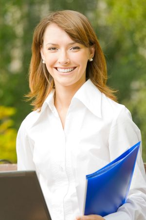 Happy smiling successful businesswoman working with laptop outdoors Stock Photo - 3324862