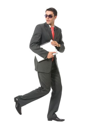 Businessman or hacker in sun glasses with laptop running, isolated photo