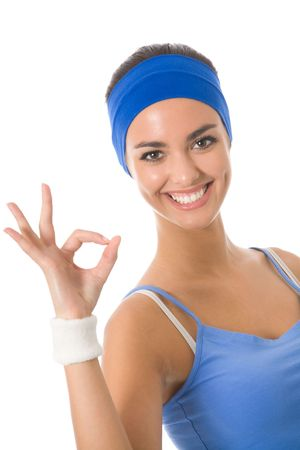 Young happy woman in sports wear gesturing, isolated on white